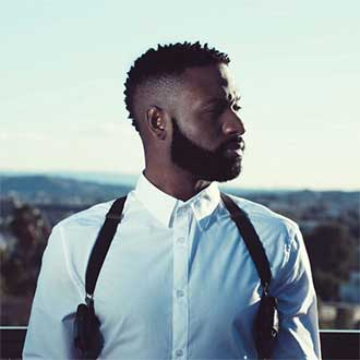 remington instagram black male with white shirt and suspenders looking to the side