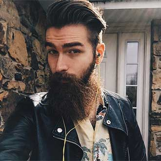 remington instagram fashionable man with big beard and ear buds