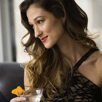 remington instagram woman with long wavy hair with cocktail