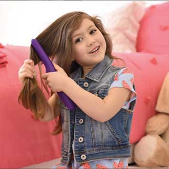 remington instagram young girl using tame the mane brush