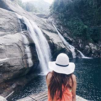 remington instagram woman looking at waterfall