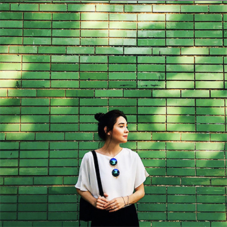 remington instagram woman standing in front of green tile