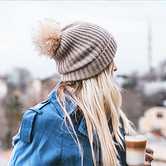 remington instagram woman with winter hat looking away
