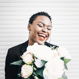 remington instagram woman holding white flowers smiling