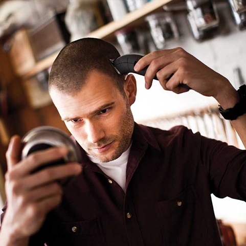 Man cutting hair with the Remington Barbershop Clipper with rechargeable battery