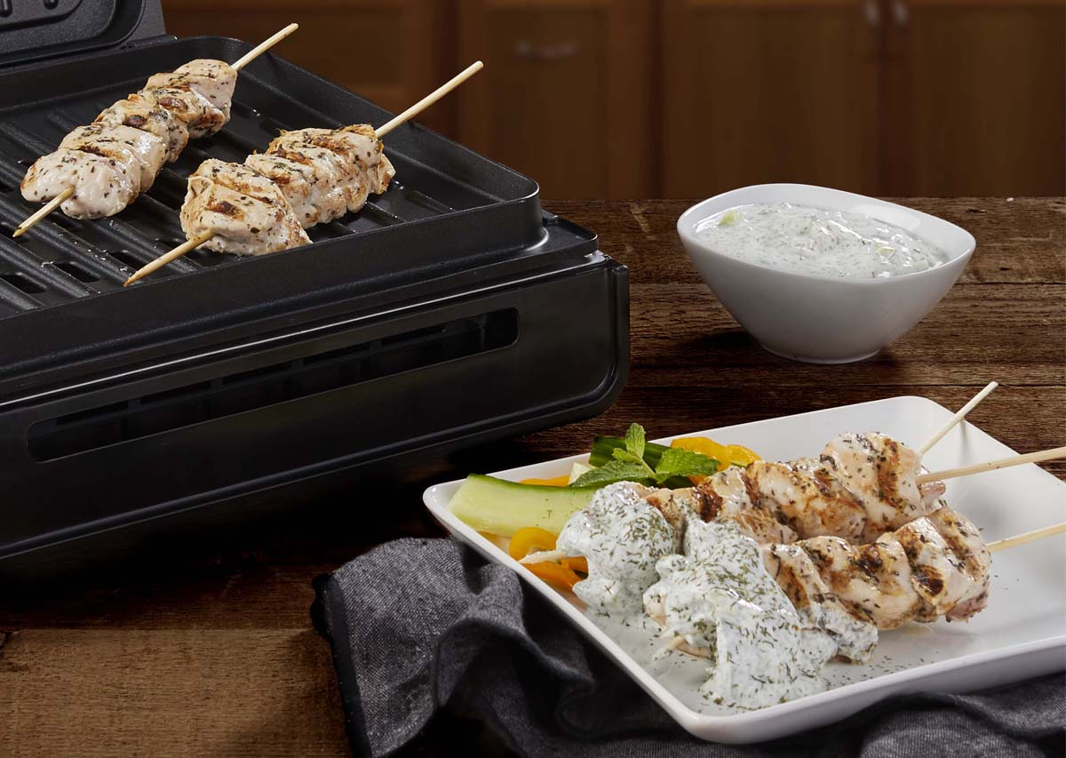 Greek chicken kabobs with tzatziki sauce and grill