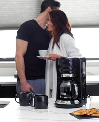 Russell Hobbs Black Coventry Coffeemaker with couple in kitchen