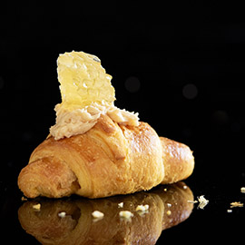 Sweet spread on croissants with honeycomb