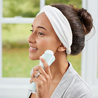 woman with beauty facial cleansing brush