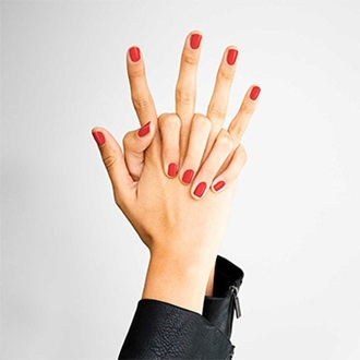Two hands with nails painted red