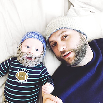 remington instagram man with baby who is wearing beard hat