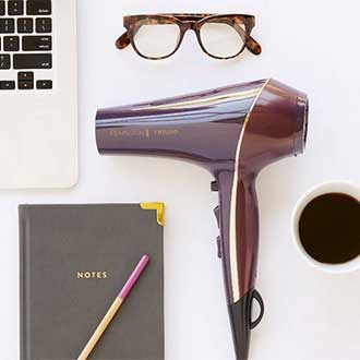 remington instagram thermaluxe hair dryer on table with glasses and notebook