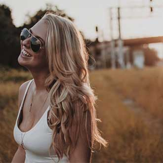 remington instagram young woman with long blonde hair and sunglasses