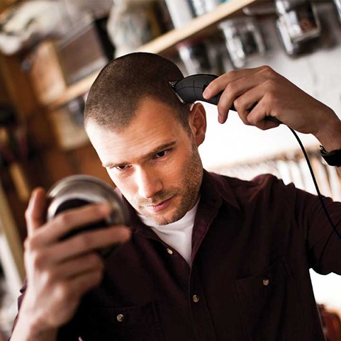 Man cutting hair with the Remington Barbershop Clipper