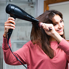 Model using the blow dryer.