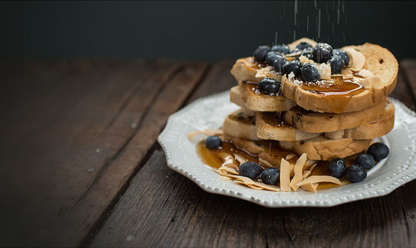 Plate with a stack of pancakes and blueberry