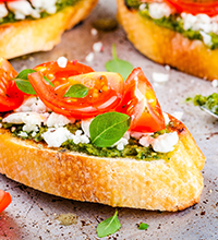 Pesto and Coat Cheese Crostini