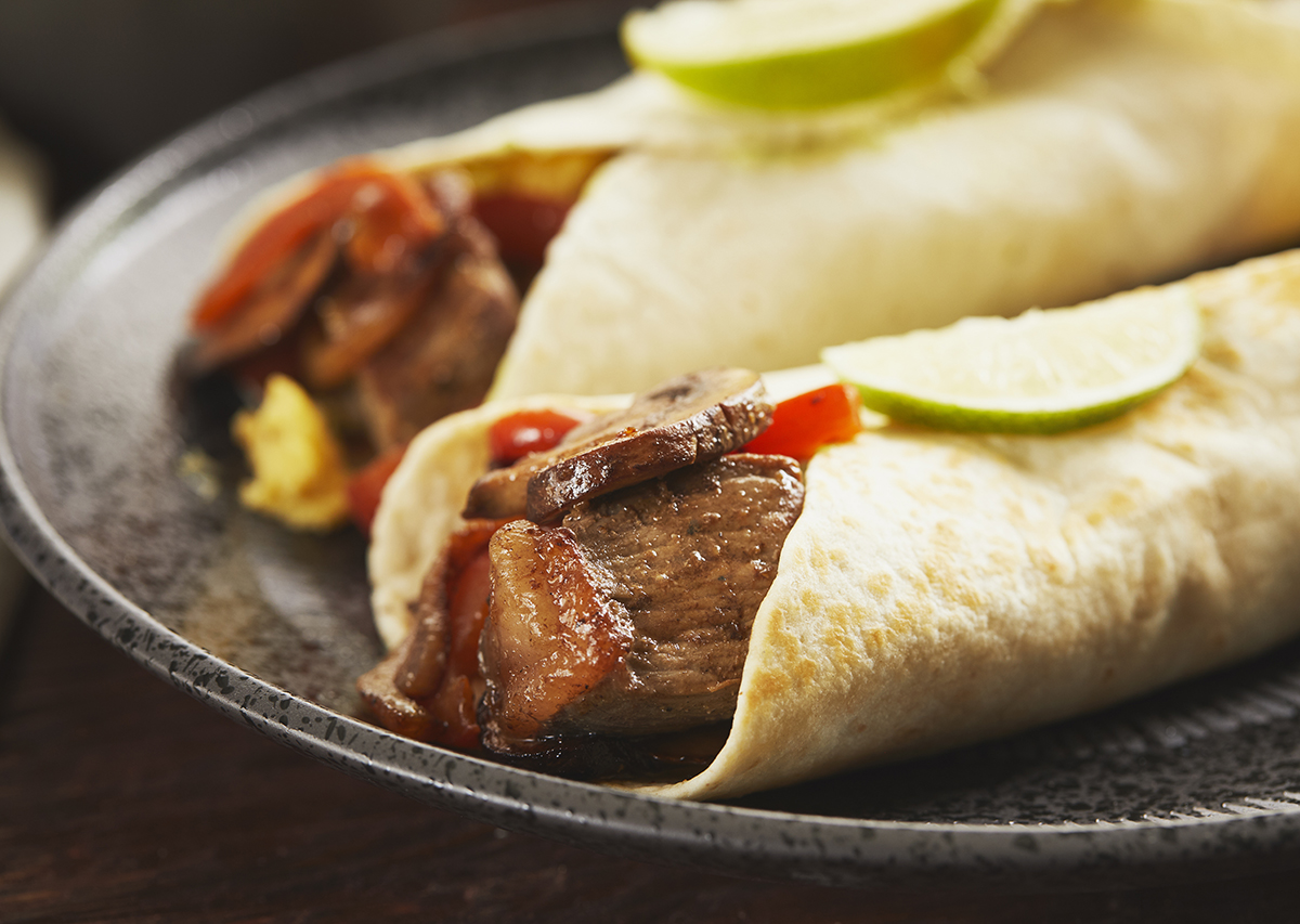 Steak and Egg Breakfast Burrito with Avocado Crema